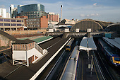Paddington station, London, overlooked by The Point office development at Paddington Basin.