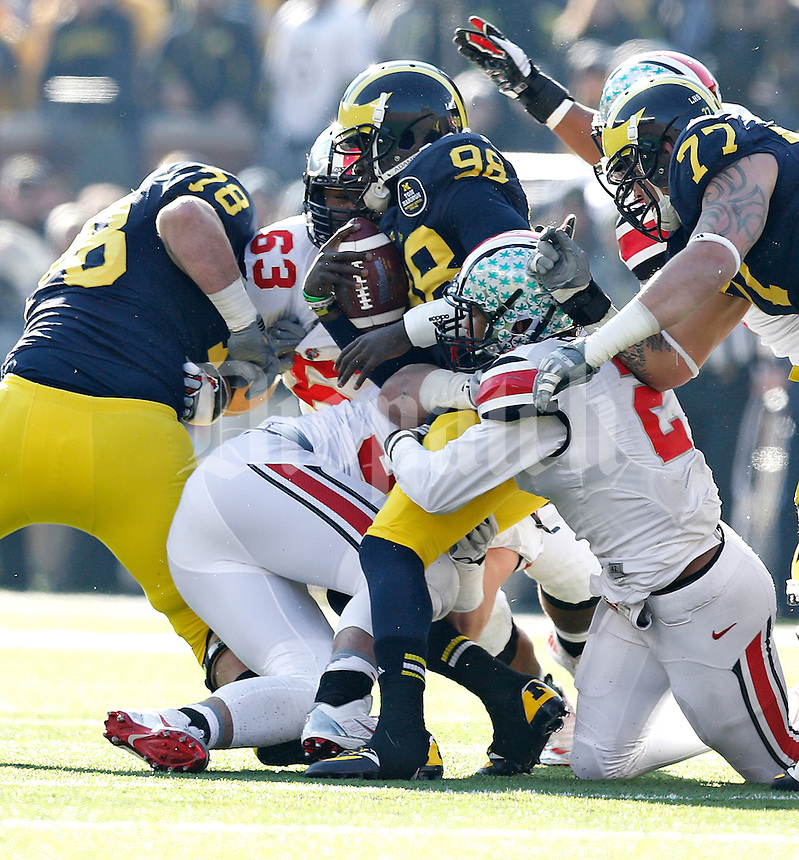 Ohio State Buckeyes line backer Ryan Shazier (2) takes down Michigan Wolverines quarterback Devin Gardner (98)in first half action at Michigan Stadium in Ann Arbor, MI on November 30, 2013.  (Chris Russell/Dispatch Photo)