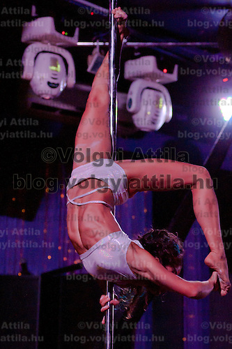 Ilka Bardoczy performs during the Miss Poledance Hungary 2011 competition in Budapest, Hungary on September 03, 2011. ATTILA VOLGYI