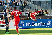 of Toronto FCRobert Earnshaw (10) celebrates scoring during the second half against the Philadelphia Union. Toronto FC and the Philadelphia Union played to a 1-1 tie during a Major League Soccer (MLS) match at PPL Park in Chester, PA, on April13, 2013.