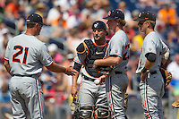 Oregon State pitcher Andrew Moore (23) is removed from the game by pitching coach Nate Yeskie (21) as catcher Jake Rodriguez (13) and second baseman Andy Peterson (14) watch during Game 11 of the 2013 Men's College World Series against the Mississippi State Bulldogs on June 21, 2013 at TD Ameritrade Park in Omaha, Nebraska. The Bulldogs defeated the Beavers 4-1, to reach the CWS Final and eliminating Oregon State from the tournament. (Andrew Woolley/Four Seam Images)
