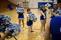 From left, Grandview High School unified basketball team cheerleaders Jenny Kern (cq), Charlotte McFall (cq), Anna Loken (cq), and Jillian Hanley (cq) cheer the starting players before a game against Overland High School at Grandview High School in Aurora, Colorado, Wednesday, February 1, 2012. Unified sports teams, an outgrowth of the Special Olympics, are teams with both special needs and traditional high school students as players. The idea is that special needs kids shouldn't be separated and be allowed to participate in a competitive games as well at their schools...Photo by Matt Nager
