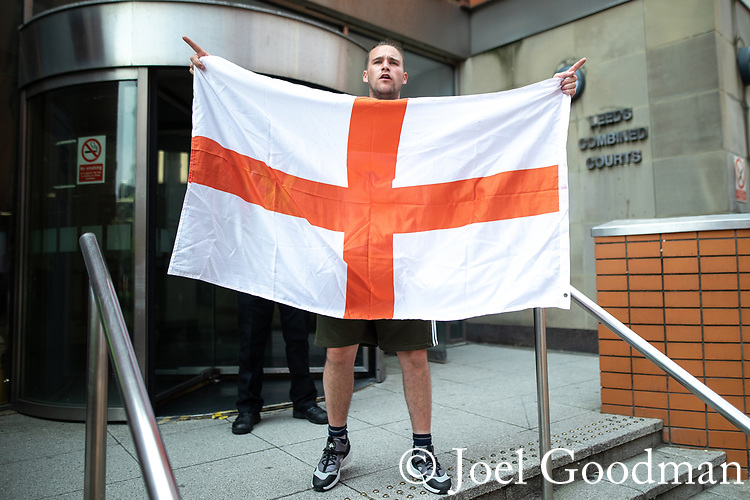 © Joel Goodman - 07973 332324 . 01/06/2018 . Leeds, UK. Supporters of EDL founder Tommy Robinson ( real name Stephen Yaxley-Lennon ) demonstrate in Leeds after Robinson was convicted of Contempt of Court . Robinson was already serving a suspended sentence for Contempt of Court over a similar incident , when he was convicted on Friday 25th May 2018 . Reporting restrictions , since lifted , initially prevented coverage of Robinson's arrest and incarceration . Photo credit : Joel Goodman