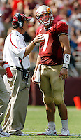 TALLAHASSEE, FL 9/18/10-FSU-BYU FB10 CH-Florida State Head Coach Jimbo Fisher directs Christian Ponder during a first half break against Brigham Young Saturday at Doak Campbell Stadium in Tallahassee. .COLIN HACKLEY PHOTO