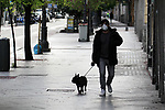 A man walks his dog down a street in Madrid during the health crisis due to the Covid-19 virus pandemic - Coronaviruss. April 26,2020. (ALTERPHOTOS/Alejandro de Dios)