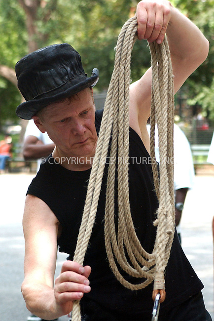 WWW.ACEPIXS.COM . . . . . ....NEW YORK, JULY 31, 2005....Philippe Petit performs his famous tightrope act in Washington Square Park.....Please byline: KRISTIN CALLAHAN - ACE PICTURES.. . . . . . ..Ace Pictures, Inc:  ..Craig Ashby (212) 243-8787..e-mail: picturedesk@acepixs.com..web: http://www.acepixs.com