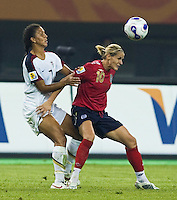 USA midfielder (7) Shannon Boxx tries to keep pressure on England midfielder (10) Kelly Smith. The United States (USA) defeated England (ENG) 3-0 during a quarter-final match of the FIFA Women's World Cup China 2007 at Tianjin Olympics Center Stadium in Tianjin, China, on September 22, 2007.