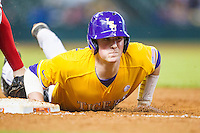 LSU Tigers catcher Michael Papierski (2) dives back to first base during the Houston College Classic against the Nebraska Cornhuskers on March 8, 2015 at Minute Maid Park in Houston, Texas. LSU defeated Nebraska 4-2. (Andrew Woolley/Four Seam Images)