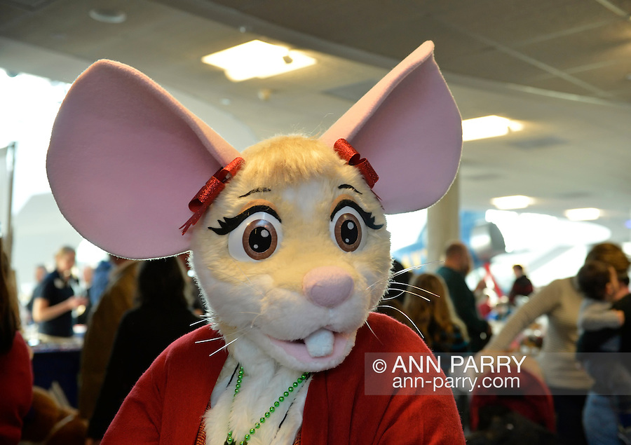 Garden City, New York, USA. December 1, 2013. The character BRIE the MOUSE is at the Winter holiday event Festival of Trees, held at Cradle of Aviation Museum during Thanksgiving weekend, with proceeds benefiting United Cerebral Palsy Association of Nassau County, Long Island.