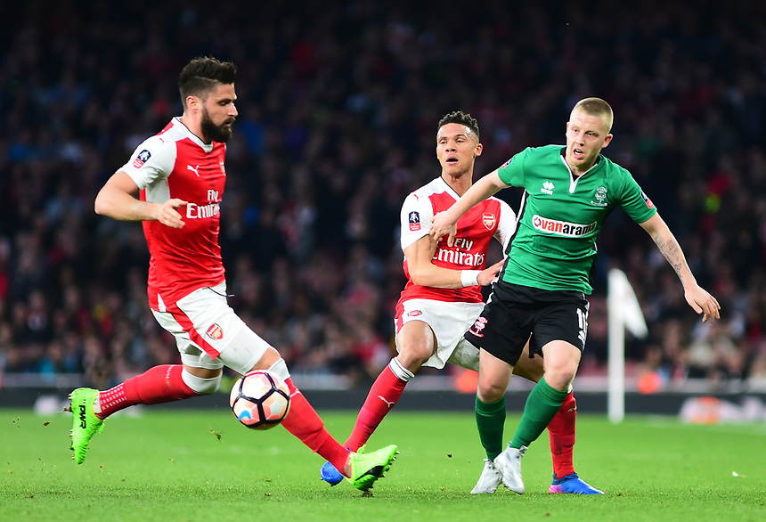 Lincoln City's Terry Hawkridge vies for possession with Arsenal's Olivier Giroud and Kieran Gibbs<br /> <br /> Photographer Andrew Vaughan/CameraSport<br /> <br /> The Emirates FA Cup Quarter-Final - Arsenal v Lincoln City - Saturday 11th March 2017 - The Emirates - London<br />  <br /> World Copyright &copy; 2017 CameraSport. All rights reserved. 43 Linden Ave. Countesthorpe. Leicester. England. LE8 5PG - Tel: +44 (0) 116 277 4147 - admin@camerasport.com - www.camerasport.com