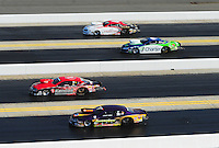 Apr. 13, 2012; Concord, NC, USA: NHRA pro stock drivers (from top) Greg Stanfield, Steve Kent, V. Gaines and Vincent Nobile race down track during qualifying for the Four Wide Nationals at zMax Dragway. Mandatory Credit: Mark J. Rebilas-