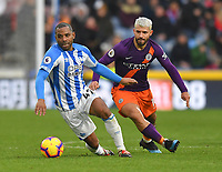 Huddersfield Town's Jason Puncheon battles with Manchester City's Sergio Aguero<br /> <br /> Photographer Dave Howarth/CameraSport<br /> <br /> The Premier League - Huddersfield Town v Manchester City - Sunday 20th January 2019 - John Smith's Stadium - Huddersfield<br /> <br /> World Copyright © 2019 CameraSport. All rights reserved. 43 Linden Ave. Countesthorpe. Leicester. England. LE8 5PG - Tel: +44 (0) 116 277 4147 - admin@camerasport.com - www.camerasport.com