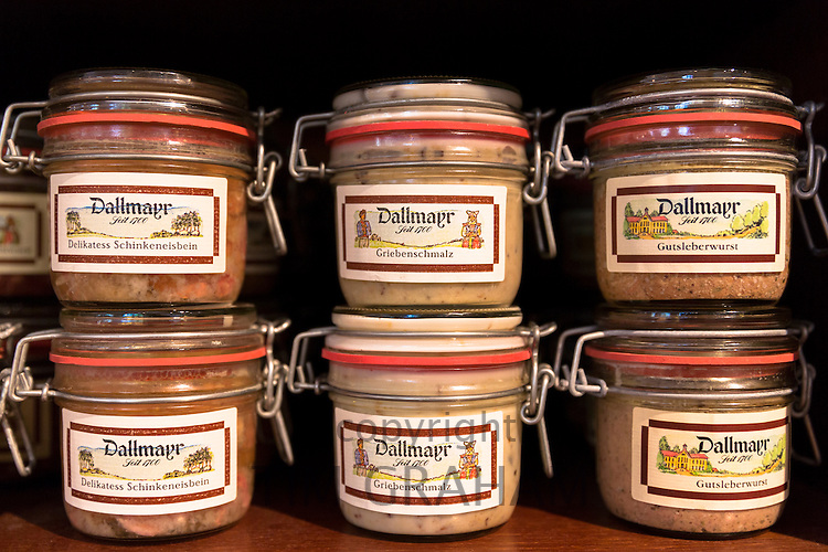 Meat pate Schinkeneisbein, Griebenschmalz, Gutsleberwurst on display in famous Dallmayr food store in Munich, Bavaria, Germany