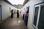 The Yushu hospital is made of plastic walls and brick floors.