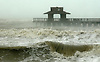 Angry seas rage as the Naples Pier is battered by wind and rains blowing in from the North on the backside of Hurricane Wilma Monday morning. Wilma blew in as a Category 3 storm beating Collier County. Erik Kellar/Staff