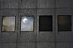 Tokyo, Japan - May 21: Reflection of an annular solar eclipse was seen on a window of a building at Shijuku, Tokyo, Japan in a morning on May 21, 2012. Last time it was seen at mainland Japan was 129 years ago.