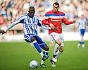 KILMARNOCK'S MOMO SISSOKO GETS AWAY FROM RANGERS' KANE HEMMINGS