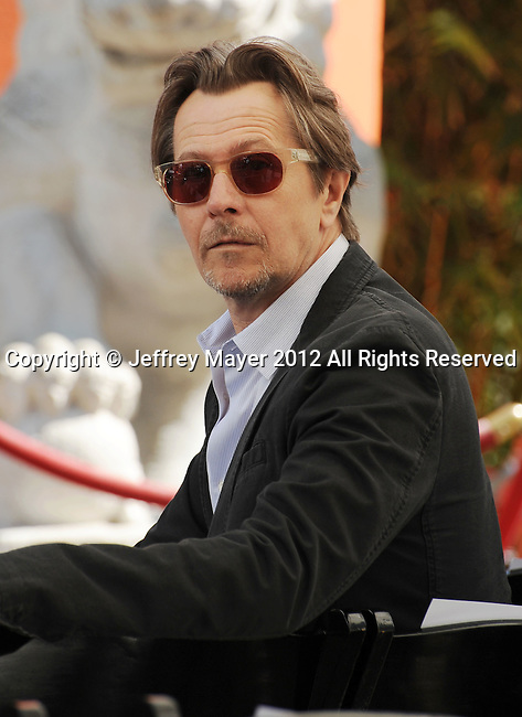 HOLLYWOOD, CA - JULY 07: Gary Oldman attends the Christopher Nolan Hand & Footprint Ceremony At Grauman's Chinese Theatre on July 7, 2012 in Hollywood, California.