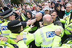 © Joel Goodman - 07973 332324 . 04/05/2013 . Leeds , UK . EDL supporters scuffle with police . The English Defence League hold a demonstration in the Moortown housing estate in Leeds over plans to convert a disused pub in to an Islamic Centre . This is the first EDL demonstration in the region since six men were convicted of planning a terrorist attack on an EDL demonstration in Dewsbury . Photo credit : Joel Goodman