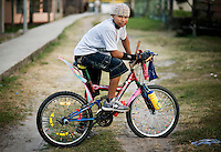 Ghamy Jackson, age 13, poses for a portrait on his bike in Pearl Lagoon, Nicaragua in April, 2009.
