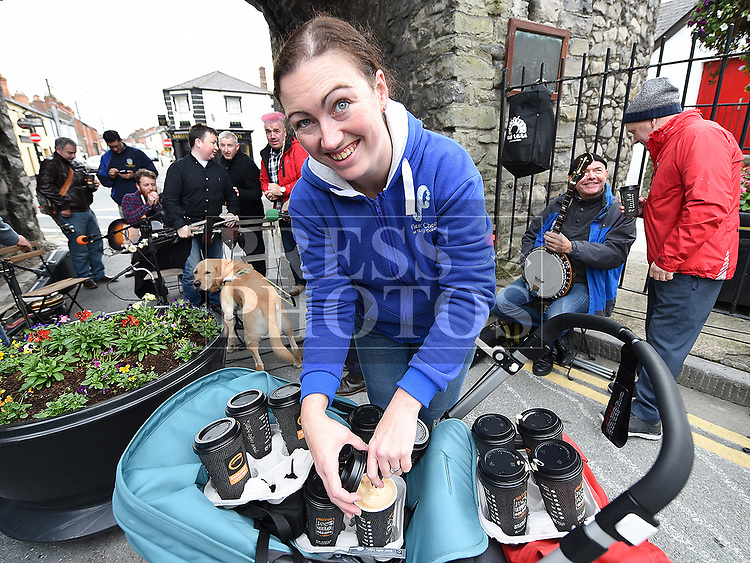 Emma ÓHéiligh distributes the coffee at the Music at the Gate. Photo:Colin Bell/pressphotos.ie