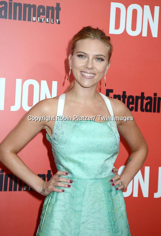 "Scarlett Johansson in Roland Moret green dress attends the ""Don Jon"" New York Movie Premiere on September 12, 2013 at the SVA Theatre in New York City."