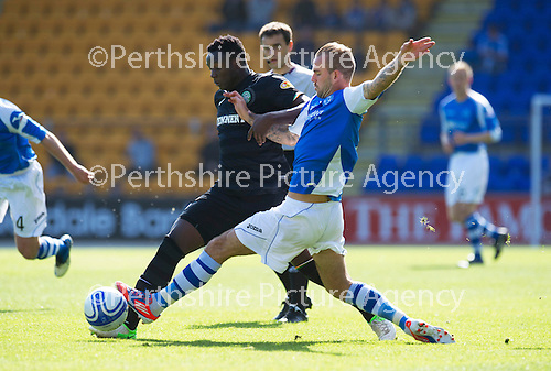 St Johnstone v Celtic....15.09.12      SPL  .Rowan Vine tackles Victor Wanyama.Picture by Graeme Hart..Copyright Perthshire Picture Agency.Tel: 01738 623350  Mobile: 07990 594431