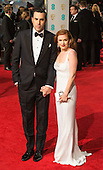 London, UK. 14 February 2016. Sasha Baron Cohen with Isla Fisher. Red carpet arrivals for the 69th EE British Academy Film Awards, BAFTAs, at the Royal Opera House. © Vibrant Pictures/Alamy Live News