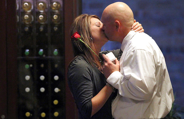 Heather Jacobs kisses her fiancee, Dan Moen after accepting his marriage proposal Sunday evening, December 5, during a night out at Django restaurant in Des Moines.  After losing her husband, Eric, in a 2006 plane crash, Heather and Dan decided to begin dating in June after meeting in April.