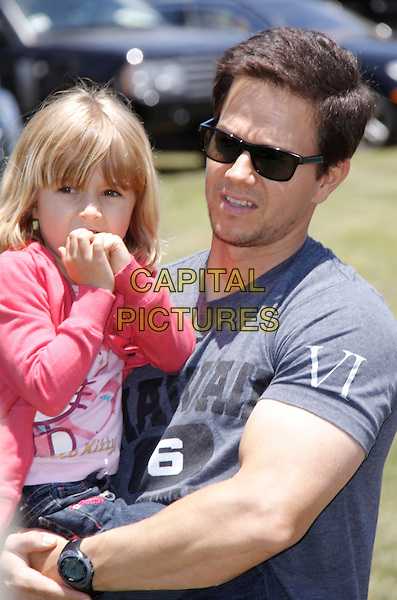 "ELLA RAE & MARK WAHLBERG.The 20th annual ""A Time for Heroes"" Celebrity Carnival benefiting Elizabeth Glaser Pediatric AIDS Foundation held at Wadsworth Theater on the Veteran Administration Lawn in West Los Angeles, California, USA. .June 7th, 2009.half length grey gray t-shirt carrying lifting daughter dad father family pink jacket sunglasses shades.CAP/DVS                                                  .©Debbie VanStory/Capital Pictures."