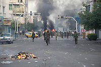 Basij (Basiji) militia and Revolutionary Guards on Khosh Street. Following a disputed election result, thousands of supporters of opposition candidate Mir-Hossein Mousavi took to the streets in protest.