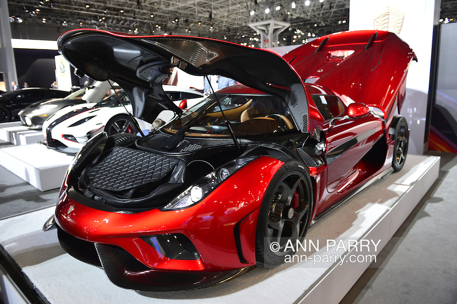 """The Koenigsegg Regera, with red exterior and black interior and costs over 2 million dollars on road, is on display with open hood and trunk at the New York International Auto Show 2016, at the Jacob Javits Center. Thirty of these cars have been sold, and Regera means """"to reign"""" in Swedish. This was Press Preview Day one of NYIAS, and the Trade Show will be open to the public for ten days, March 25th through April 3rd."""