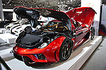 "The Koenigsegg Regera, with red exterior and black interior and costs over 2 million dollars on road, is on display with open hood and trunk at the New York International Auto Show 2016, at the Jacob Javits Center. Thirty of these cars have been sold, and Regera means ""to reign"" in Swedish. This was Press Preview Day one of NYIAS, and the Trade Show will be open to the public for ten days, March 25th through April 3rd."