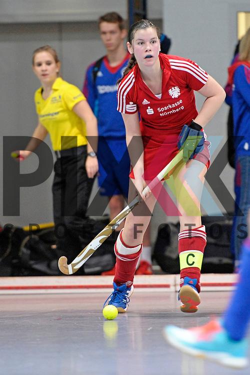 GER - Mannheim, Germany, December 19: During the 1. Bundesliga Sued Damen indoor hockey match between Mannheimer HC (blue) and Nuernberger HTC (red) on December 19, 2015 at Irma-Roechling-Halle in Mannheim, Germany. Final score 8-2 (HT 3-2).  Lena Strobel #25 of Nuernberger HTC<br /> <br /> Foto &copy; PIX-Sportfotos *** Foto ist honorarpflichtig! *** Auf Anfrage in hoeherer Qualitaet/Aufloesung. Belegexemplar erbeten. Veroeffentlichung ausschliesslich fuer journalistisch-publizistische Zwecke. For editorial use only.