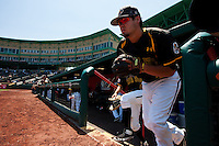 Dayne Parker (11) of the Wichita State Shockers runs out onto the field during a game against the Missouri State Bears in the 2012 Missouri Valley Conference Championship Tournament at Hammons Field on May 23, 2012 in Springfield, Missouri. (David Welker/Four Seam Images)