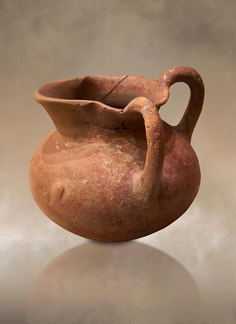 Hittite terra cotta two handled pitcher. Hittite Period, 1600 - 1200 BC.  Hattusa Boğazkale. Çorum Archaeological Museum, Corum, Turkey. Against a warm art bacground.