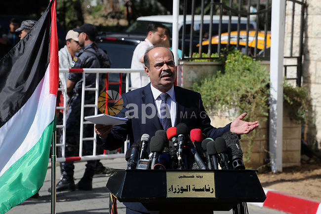 Spokesman for the Palestinian government, Yousef Al Mahmoud, speaks to media following a reconciliation cabinet meeting in Gaza City on October 3, 2017. The Palestinian reconciliation government met in Gaza for the first time since 2014 as moves intensifies to end the decision-old rift between the main political factions. Photo by Mohammed Asad