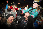 © Joel Goodman - 07973 332324 . 17 November 2013 . Oldham , UK . People in front of the stage enjoying the night out . The Christmas lights are turned on in Oldham Town Centre . Photo credit : Joel Goodman