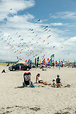 USA, Washington State, Long Beach Peninsula, International Kite Festival, family enjoys the beach at the kite festival