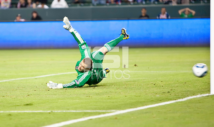 Philadelphia goalie Chris Seitz dives to attempt to block the goal scoring kick by Chivas midfielder Blair Gavin during the first half of the game between Chivas USA and the Philadelphia Union at the Home Depot Center in Carson, CA, on July 3, 2010. Chivas USA 1, Philadelphia Union 1.