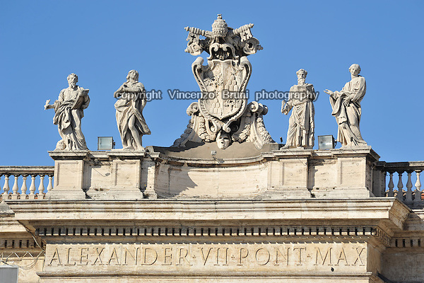 The coat of arms of Pope Alexander VII (Fabio Chigi) atop Gianlorenzo Bernini's colonnade in St. Peter's Square in Rome, Italy.