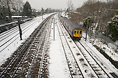 First Capital Connect train on the Thameslink line following a snowfall, Cricklewood, London.