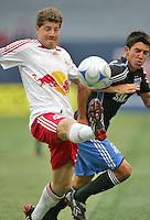 New York Red Bulls' Luke Sassano, left, beats San Jose Earthquakes' Shea Salinas (15) to the ball in the first half of an MLS soccer match at Giants Stadium in East Rutherford, N.J. on Sunday, April 27, 2008. The Red Bulls defeated the Earthquakes 2-0.