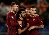 Calcio, Serie A: Roma, stadio Olimpico, 19 febbraio 2017.<br /> Roma&rsquo;s Mohamed Salah celebrates with his teammates Edin Dzeko Bruno Peres and Leandro Paredes after scoring during the Italian Serie A football match between As Roma and Torino at Rome's Olympic stadium, on February 19, 2017.<br /> UPDATE IMAGES PRESS/Isabella Bonotto