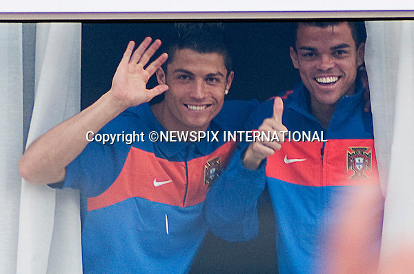 """EXCLUSIVE!! .Must telephone +441279 324672 for reproduction fees and usage..CRISTIANO RONALDO AND TEAM-MATE PEPE.give a thumbs up to waiting fans as he arrives at the hotel prior to Portugal's first game with Cote D'Ivoire in Port Elizabeth..Unfortunately the team had to contend with torrential on the first practice session_14/06/2010.Mandatory Credit Photos: ©Newspix International..**ALL FEES PAYABLE TO: """"NEWSPIX INTERNATIONAL""""**..PHOTO CREDIT MANDATORY!!: NEWSPIX INTERNATIONAL(Failure to credit will incur a surcharge of 100% of reproduction fees)..IMMEDIATE CONFIRMATION OF USAGE REQUIRED:.Newspix International, 31 Chinnery Hill, Bishop's Stortford, ENGLAND CM23 3PS.Tel:+441279 324672  ; Fax: +441279656877.Mobile:  0777568 1153.e-mail: info@newspixinternational.co.uk"""