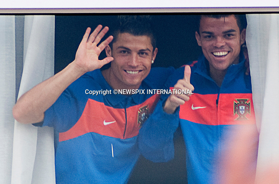 "EXCLUSIVE!! .Must telephone +441279 324672 for reproduction fees and usage..CRISTIANO RONALDO AND TEAM-MATE PEPE.give a thumbs up to waiting fans as he arrives at the hotel prior to Portugal's first game with Cote D'Ivoire in Port Elizabeth..Unfortunately the team had to contend with torrential on the first practice session_14/06/2010.Mandatory Credit Photos: ©Newspix International..**ALL FEES PAYABLE TO: ""NEWSPIX INTERNATIONAL""**..PHOTO CREDIT MANDATORY!!: NEWSPIX INTERNATIONAL(Failure to credit will incur a surcharge of 100% of reproduction fees)..IMMEDIATE CONFIRMATION OF USAGE REQUIRED:.Newspix International, 31 Chinnery Hill, Bishop's Stortford, ENGLAND CM23 3PS.Tel:+441279 324672  ; Fax: +441279656877.Mobile:  0777568 1153.e-mail: info@newspixinternational.co.uk"