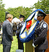 Washington, DC - May 15, 2004 -- United States President George W. Bush pauses for a moment after placing a flower in the memorial wreath at the Annual Peace Officers' Memorial Service on the West Lawn of the United States Capitol in Washington, D.C. on May 15, 2004.  The service, sponsored by the Fraternal Order of Police (FOP), is held annually on May 15 to honor those who gave their lives during the previous year and to honor their families.  The service remembers the sacrifice of the more than 15,000 officers who have been killed in the line of duty since 1794.<br /> Credit: Ron Sachs / CNP<br /> (RESTRICTION: NO New York or New Jersey Newspapers or newspapers within a 75 mile radius of New York City)