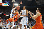 02 February 2013: Virginia Tech's Marquis Rankin (10), guarded by North Carolina's James Michael McAdoo (43) and Brice Johnson (11), passes the ball to Virginia Tech's Christian Beyer (right). The University of North Carolina Tar Heels played the Virginia Tech Hokies at the Dean E. Smith Center in Chapel Hill, North Carolina in an NCAA Division I Men's college basketball game. UNC won the game 72-60 after overtime.