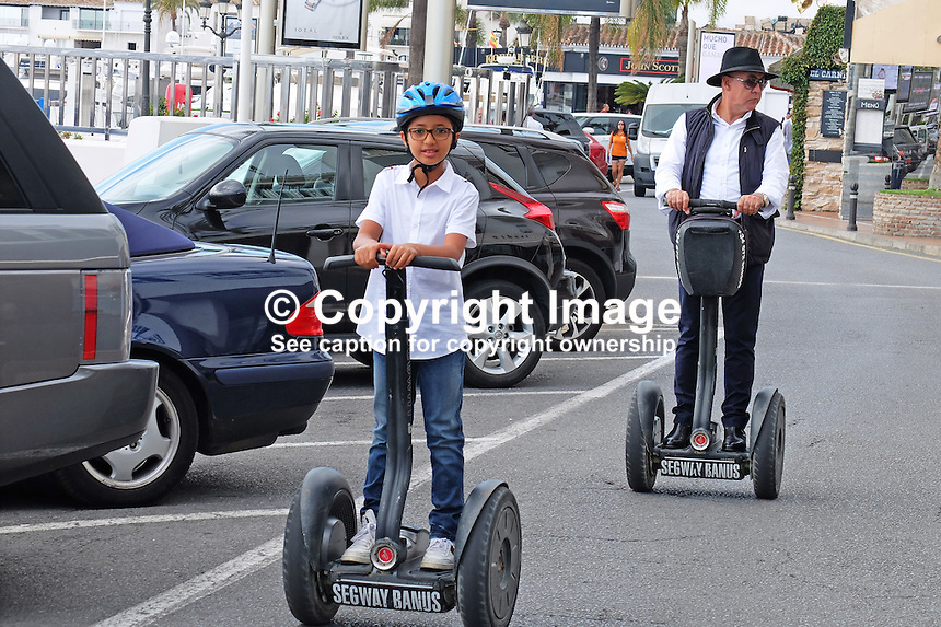 Segways are a great way to get around Puerto Banus, Marbella, Spain, October, 2013, 201310141716<br /> <br /> Copyright Image from Victor Patterson, 54 Dorchester Park, Belfast, UK, BT9 6RJ<br /> <br /> t1: +44 28 9066 1296 (from Rep of Ireland 048 90661296)<br /> t2: +44 28 9002 2446 (from Rep of Ireland 048 90022446)<br /> m: +44 7802 353836<br /> <br /> e1: victorpatterson@me.com<br /> e2: victorpatterson@gmail.com<br /> <br /> www.victorpatterson.com<br /> <br /> IMPORTANT: Please see my Terms and Conditions of Use at www.victorpatterson.com