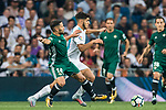 Marco Asensio Willemsen (r) of Real Madrid fights for the ball with Riza Durmisi of Real Betis during the La Liga 2017-18 match between Real Madrid and Real Betis at Estadio Santiago Bernabeu on 20 September 2017 in Madrid, Spain. Photo by Diego Gonzalez / Power Sport Images